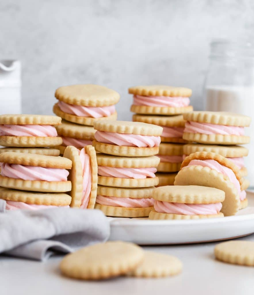 Vanilla Bean Sandwich Cookies with Strawberry Buttercream Filling with Rodelle Vanilla Paste stacked on plate