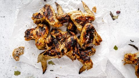 Turkey Brined Chicken Wings plated on a white backdrop